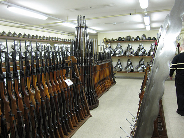 SIG-MKPO-subguns-on-bottom-left-and-MP43-44s-top-left-ready-to-go-in-the-Swiss-Guards-armory-note-the-two-handed-swords-to-the-right